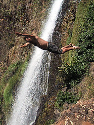 diving into the pool below  the El Cora waterfall